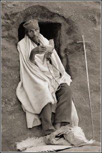 photograph of desert monk with plated prayer rope